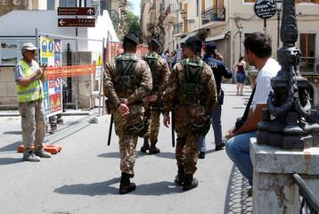 Italian soldiers patrol in the Sicilian town of Taormina
