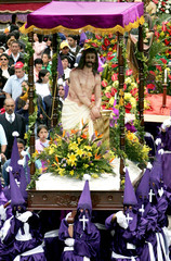 Penitents take part in procession during Holy Week in Zipaquira