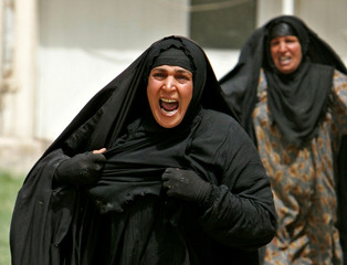 Women run towards Yarmouk Hospital after learning their sons were killed in Baghdad suicide attack.