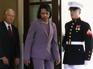 U.S. Secretary of Defense Robert Gates and Secretary of State Condoleezza Rice walk down the driveway to make a statement at the White House in Washington