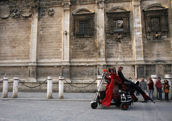 Performers perform during the show 'Motards' in central Seville