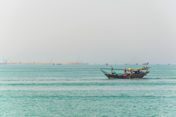 View of a dhow ship on an open sea in Kuwait.