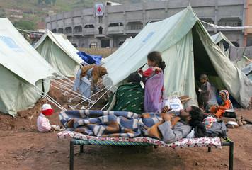 Kashmiri earthquake survivor family spend time at evacuation tent camp in Muzaffarabad