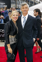Director Luhrmann and his wife Catherine Martin walk on the red carpet at the 2005 AFI awards in Melbourne