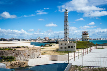 Lighthouse and Castle of San Sebastian in Cadiz on a sunny day in March 2017, Andalusia, Spain