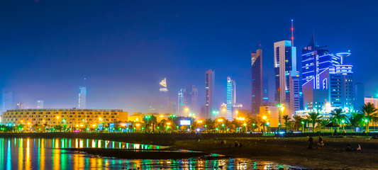 Skyline of Kuwait during night including the Seif palace and the National assembly building.
