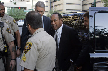 O.J. Simpson arrives with his attorneys at the Clark County Regional Justice Center on the first day of jury selection for his trial in Las Vegas