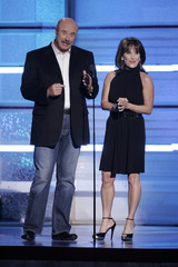 Phil and Robin Mcgraw present an award during Academy of Country Music Awards show at the MGM Grand Garden Arena in Las Vegas