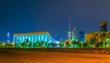 Skyline of Kuwait with the National assenbly building and the Liberation tower during night.