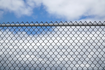 iron chain link fence against sky