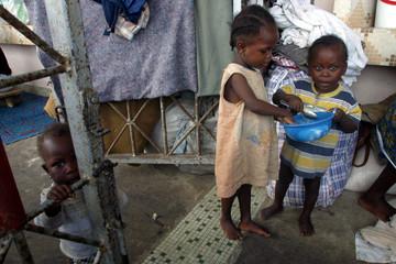 DISPLACED LIBERIAN CHILDREN EAT AT SPORTS STADIUM IN MONROVIA.