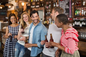 Cheerful friends enjoying at pub