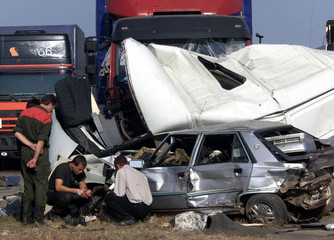 Belarussian police officers Investigate the multiple car crash scene on the road from Minsk to Mosco..