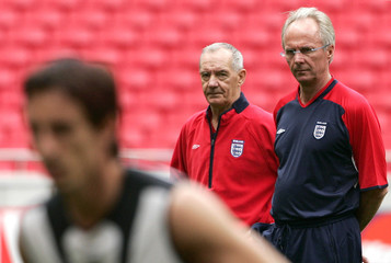 ENGLAND'S ERIKSSON AND GRIP WATCH THEIR SQUAD DURING A TRAINING SESSION AT THE LUZ STADIUM IN LISBON.
