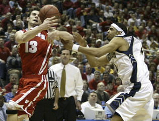 PITTSBURGHS MCARROLL AND WISCONSINS HANSON STRUGGLE FOR CONTROL OF BALL.