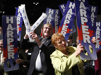 Supporters cheer while they wait for Conservative leader and Canada's PM Harper at his election night headquarters in Calgary