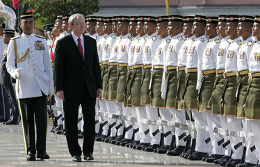 Australia's Prime Minister Kevin Rudd inspects the guard of honour during an official welcoming ceremony in Putrajaya