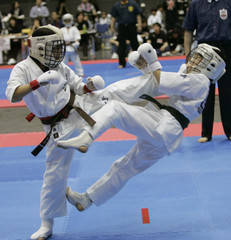 Japan's Hashioka kicks compatriot Ichinose in the 10 and 11-year-old girl's competition of International Karate Friendship 2007 in Chiba