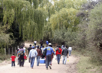 People leave the competition area of the seven stage of the second leg of the Rally of Argentina