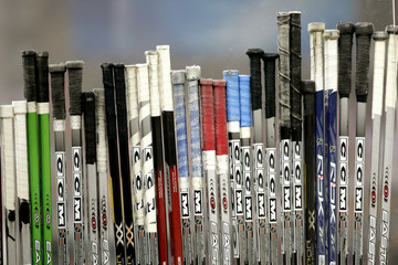 Hockey sticks are lined up on the Czech Repulic's bench during ice hockey game against Germany at the Winter Olympic Games