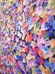 Wishes posted on a wall.