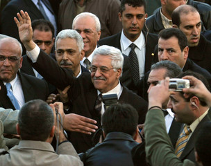 Palestinian presidential candidate Mahmoud Abbas waves to supporters during a campaign stop in Jericho.