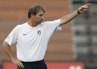 South Korea's head coach Pim Verbeek from the Netherlands directs his players during a training session in preparation for the 2007 AFC Asian Cup soccer tournament in Jakarta