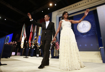 U.S. President Obama walks on stage with first lady Michelle during the Western States Inaugural Ball in Washington
