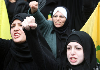 Lebanon's Hezbollah women supporters shout slogans during a rally in Beirut's southern suburbs to express solidarity with Palestinians in Gaza