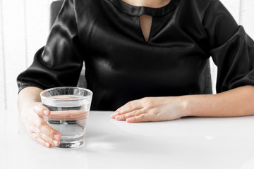 Female hand holding a glass of water