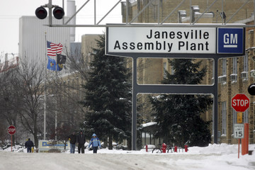 Workers leave the GM plant in Janesville