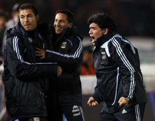 Argentina's head coach Maradona celebrates after a goal against Colombia in their 2010 World Cup qualifying soccer match in Buenos Aires