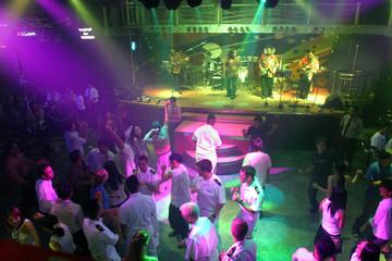 U.S. sailors dance at a nightclub in Vietnam's central city of Danang.