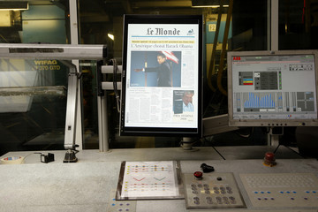 French daily Le Monde which announces the victory of U.S. President-elect Obama on the front page is seen on a screen at their printing press in Ivry-sur-Seine near Paris