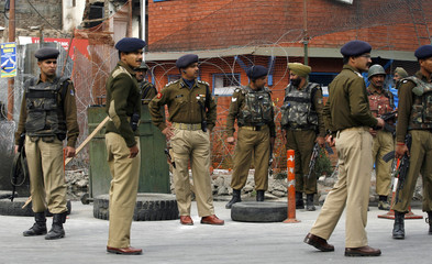Indian police gather outside their camp during a strike in Srinagar