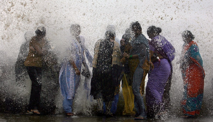 BEST QUALITY AVAILABLE  People get drenched in a large wave during high tide at a sea front in Mumbai