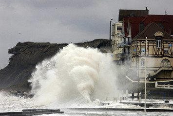 Waves hit the sea wall in Wimereux, northern France