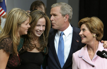 US President George W. Bush poses with family after victory speech to supporters.