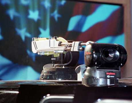 A simulated laser gun and night vision equipment is shown on top of the SmarTruck, the latest versio..