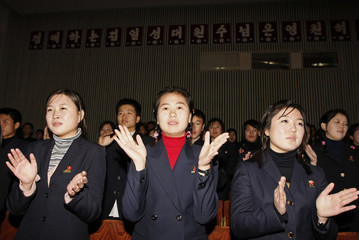 North Korean students applaud at the end of a show performed by their colleague students for visitors at a hall at the Kumsung School in Pyongyang