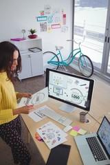 Confident graphic designer working in creative office