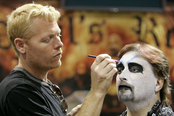 """Make-up artist Michael Davis works on Rick Winters to make him look like """"Capt. Spalding"""" at Comic-Con ..."""
