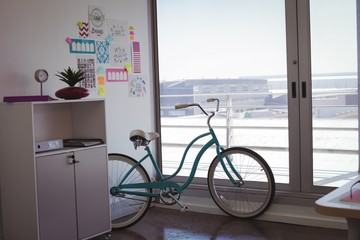 Bicycle by window in office