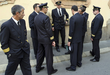 Alitalia pilots standing outside at Clerici Palace downtown in Milan