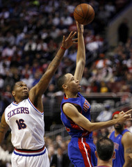 Detroit Pistons forward Prince shoots under pressure from Philadelphia 76ers forward Speights during the second quarter of NBA basketball action in Philadelphia