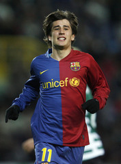 Barcelona's Bojan celebrates his goal against Sporting during their Champions League soccer match in Lisbon