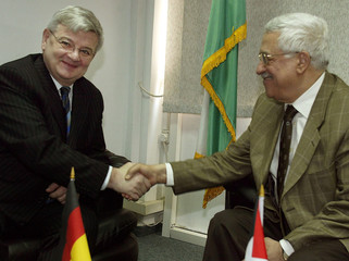 PLO chairman Abbas and German FM Joschka Fischer shake hands during meeting in West Bank city of Ramallah.