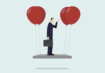 Self sabotage concept: businessman pushing needle to pop the balloon.