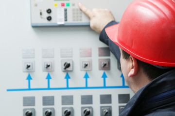 Electrician give command in power plant control center