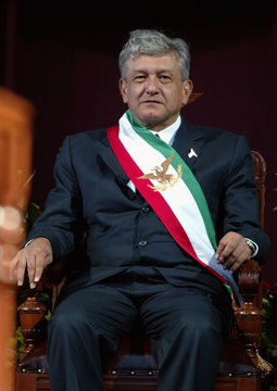 """Andres Manuel Lopez Obrador looks at supporters after he was sworn in as """"legitimate president""""  at Mexico City's Zocalo square"""